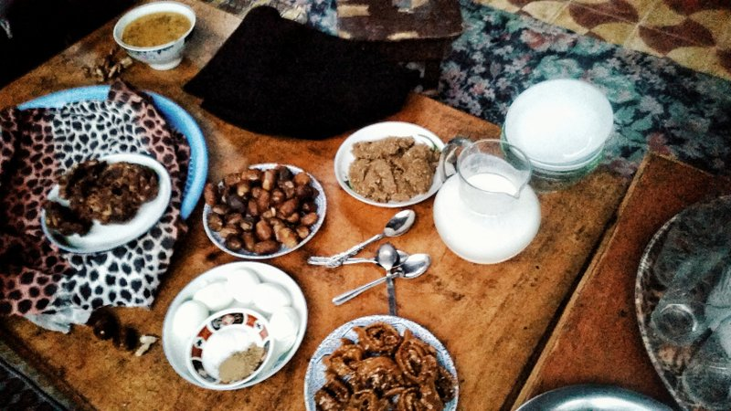 dates, hardboiled eggs and other snacks on a table