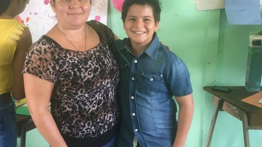 My student was so happy his mom was able to make it  all the way from their community for his graduation