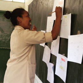 Girl drawing what she thinks is the 'ideal' latrine for girls to use when on their period at school