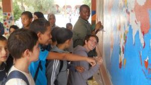Painting a mural with another Peace Corps Volunteer