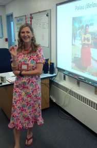 Laura wears a muumuu and explains Palauan first childbirth ceremony to fifth graders.