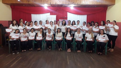 Women with their certificates