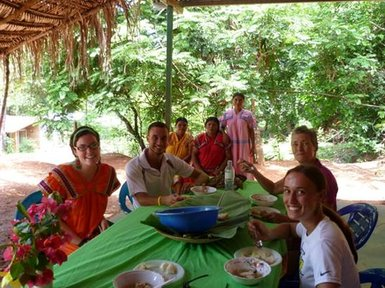 Jack's community's first tourists having a traditional lunch during their day tour (2011)