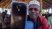 man with phone benin