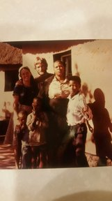 Marie and Kirk with their host family during training in Lesotho.