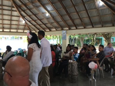 My host family's sister's wedding at Camalote, Belize, a small village outside the capital city of Belmopan. The bride is being escorted by her mother. The wedding celebration included the wedding ceremony, dinner, and a dance.