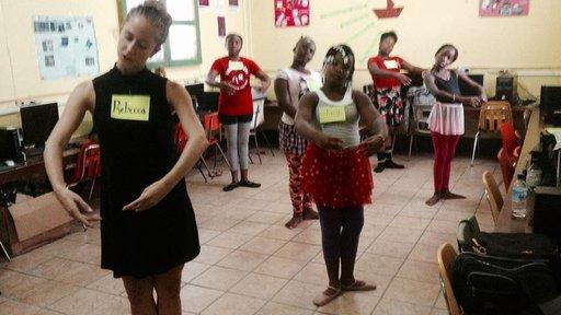 Teaching ballet in the schools.