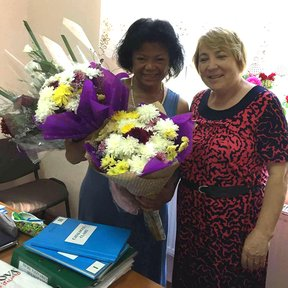 Volunteer Donna B., formerly a professor at Howard University, and her partner Eudochia Babalici, school director.