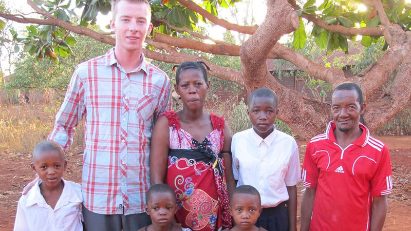 Robbie Lehman with a family in Tanzania
