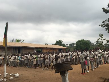 Students at an outside assembly.