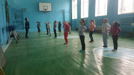 Students' participating in a warm-up during physical education.