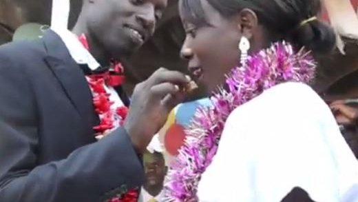 A Malawian couple celebrate their marriage with their community.