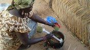 Woman cooking with moringa