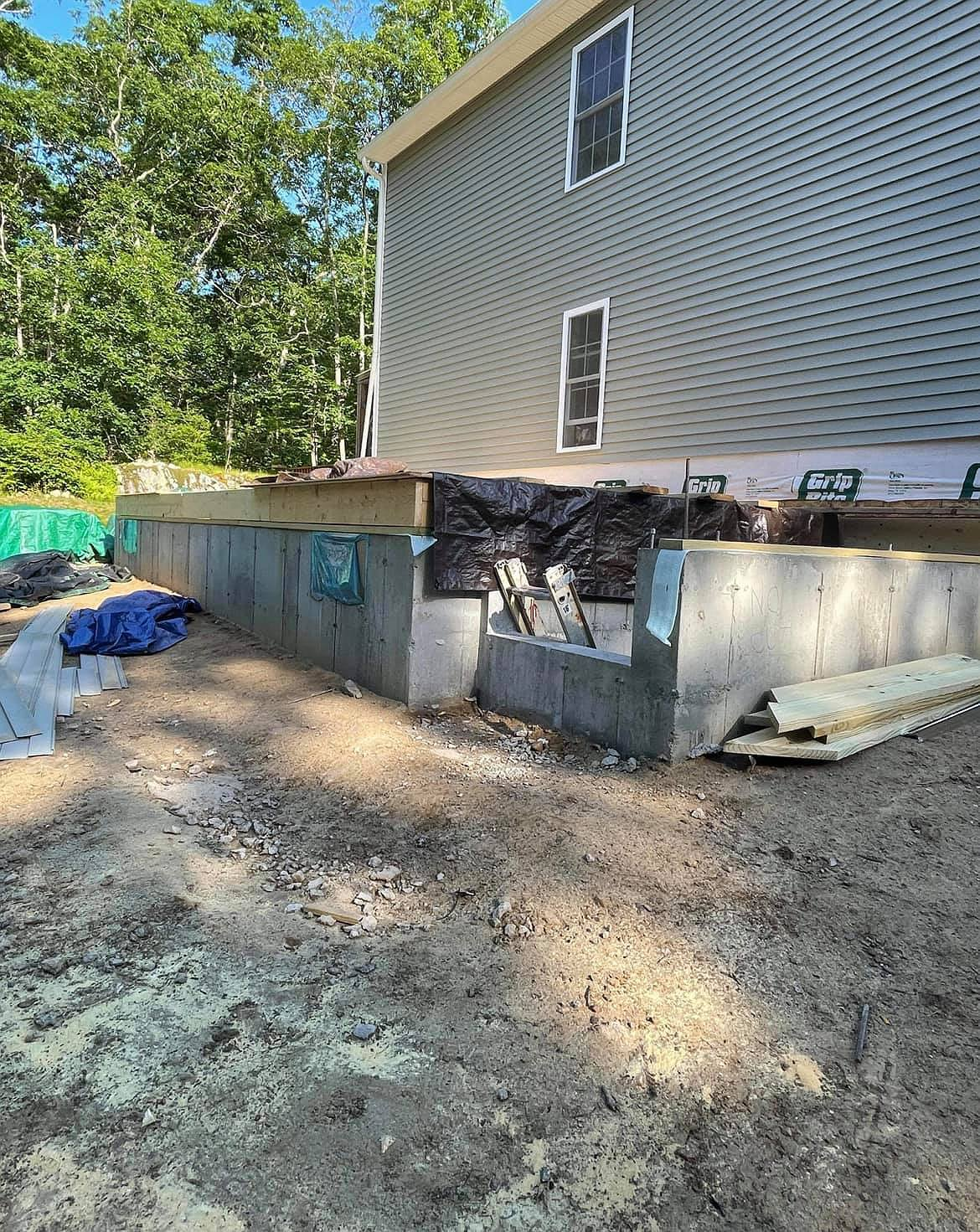 Home and yard before and after contractor demolished them both