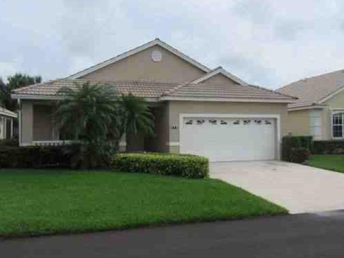 Photograph of 910 NW Sarria Ct, Port Saint Lucie, FL 34986