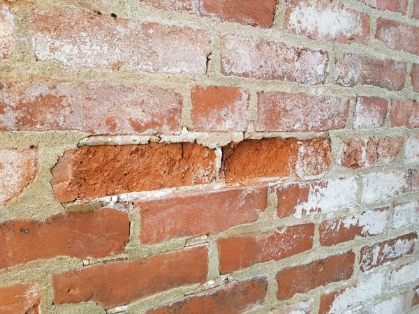 Damaged brick: T, h, e, r, e,  , i, s,  , d, a, m, a, g, e, d,  , a, n, d,  , s, p, a, l, l, i, n, g,  , b, r, i, c, k,  , o, n,  , t, h, e,  , e, x, t, e, r, i, o, r,  , w, a, l, l, .,  , R, e, c, o, m, m, e, n, d,  , r, e, p, a, i, r, i, n, g,  , t, h, e,  , b, r, i, c, k,  , t, o,  , p, r, e, v, e, n, t,  , f, u, r, t, h, e, r,  , d, e, t, e, r, i, o, r, a, t, i, o, n,  , a, n, d,  , d, a, m, a, g, e, .