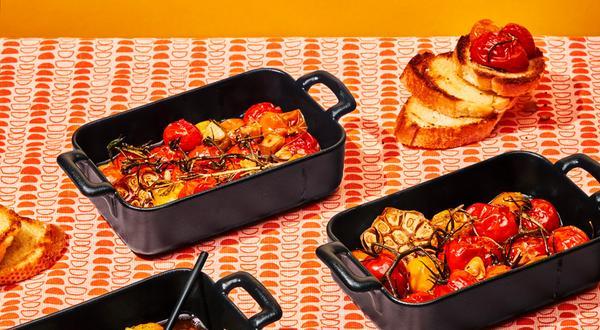 Tomates cerises et ail confits au romarin et au beurre