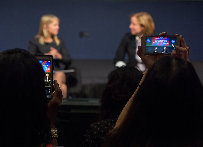 Participants videoing fireside chat with Dr. Dava Newman and USCTO Megan Smith at NASA's White House United State of Women Summit. Photo Credit: NASA/Aubrey Gemignani