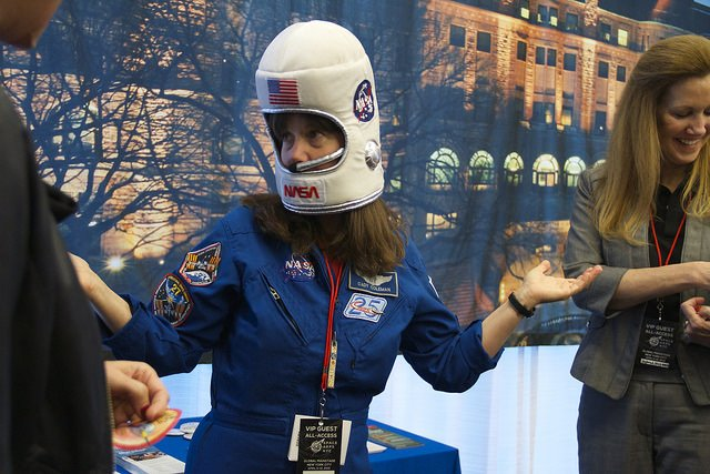 Astronaut Cady Coleman trying out a space helmet. NASA's CTO-IT Deborah Diaz at right.