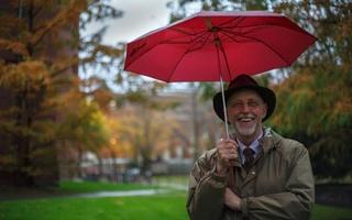 Dean Pfister with an umbrella