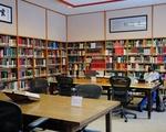 Student studies in spacious reading room