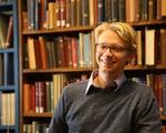 Luke Heine in the library