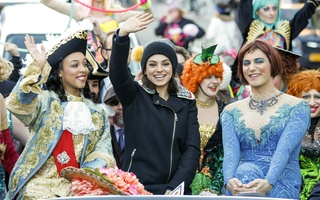 Mila Kunis Waves to the Crowds
