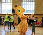 Giraffe Dances at Ballroom Competition