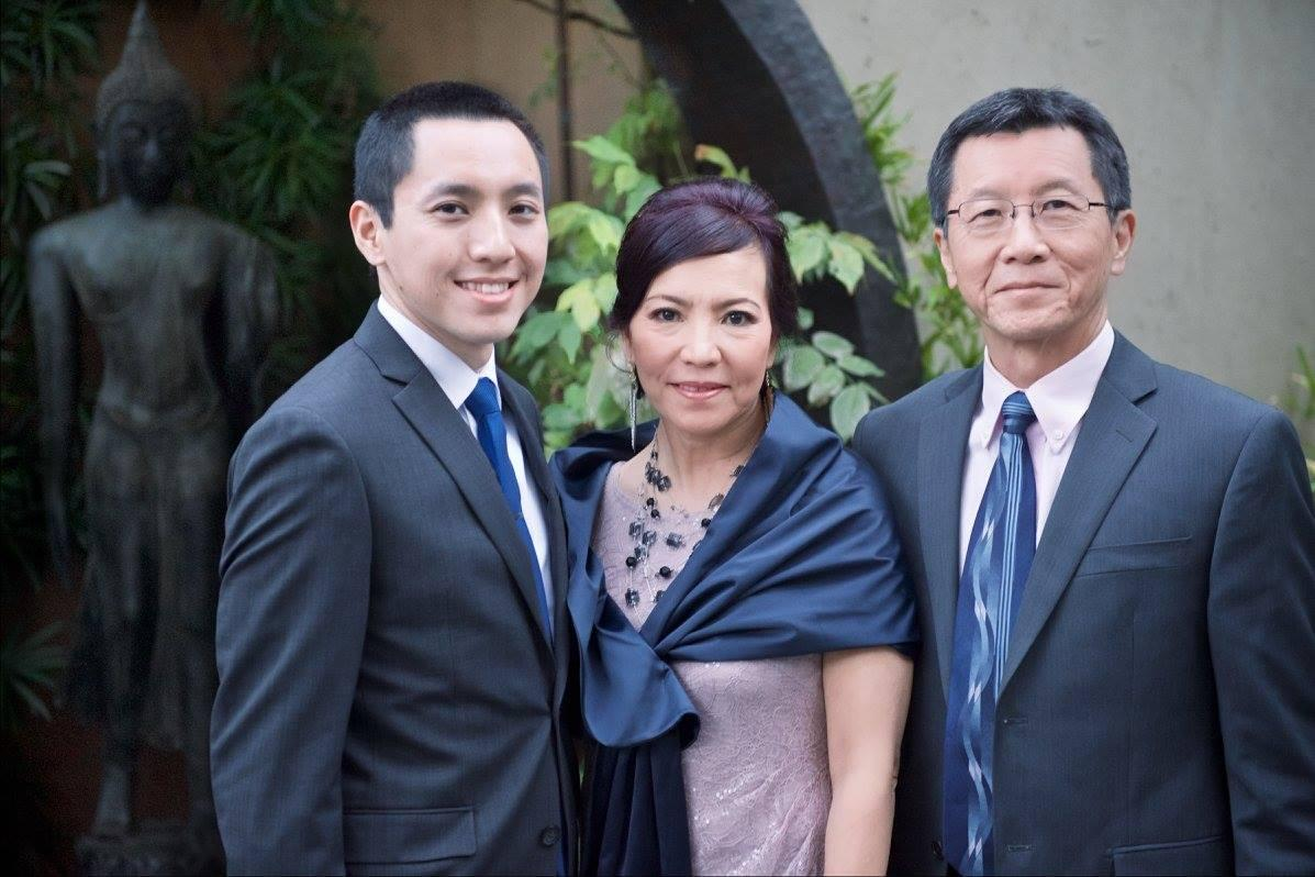 Alex and his parents at his cousin's wedding